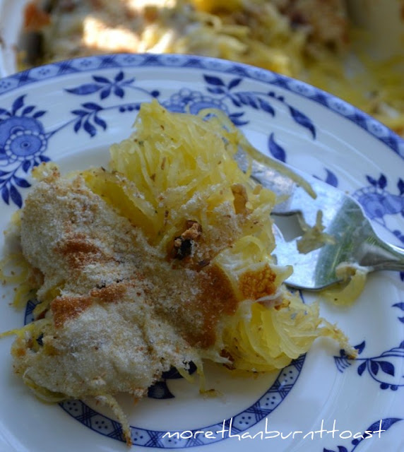 spaghetti squash on a plate with cheese