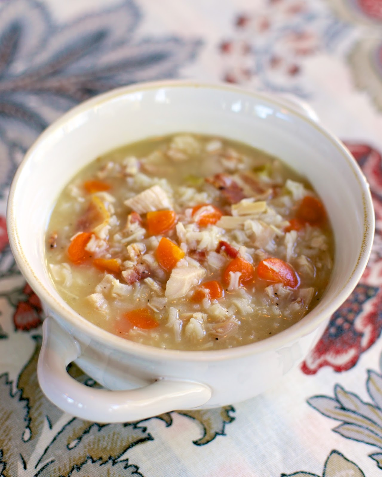 Chicken, Bacon & Rice Soup recipe - chicken broth, water, rice, cream of celery soup, carrots, bacon and chicken - use a rotisserie chicken and this soup is ready in 20 minutes! Just dump everything in the pot, bring to a boil and simmer. So easy and super delicious! Can also use uncooked chicken breast and make in the slow cooker.
