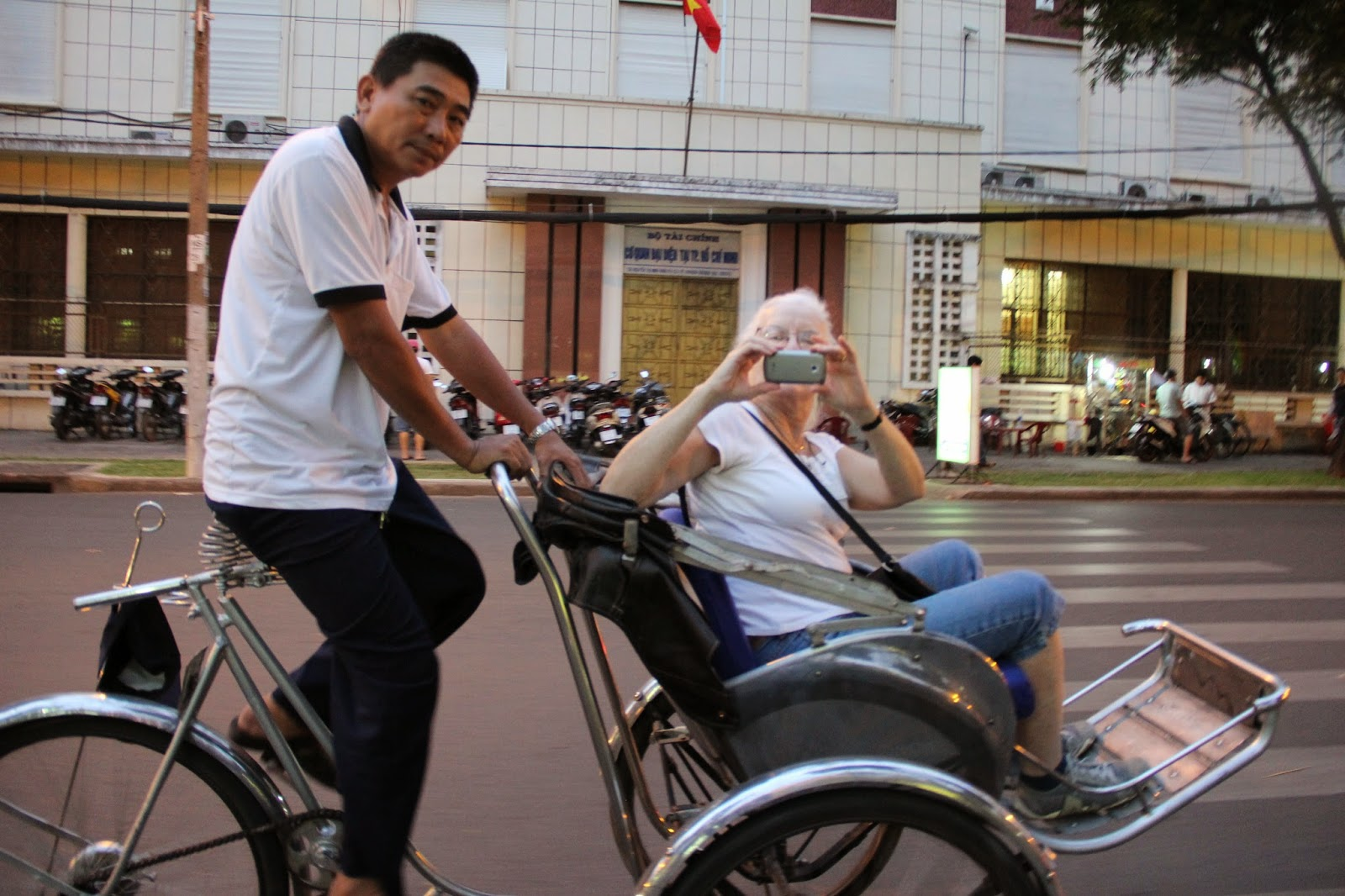 Taking a picture while riding on a cyclo, or pedicab in HCMC.