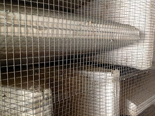 fiberglass acoustic wedges behind wire mesh