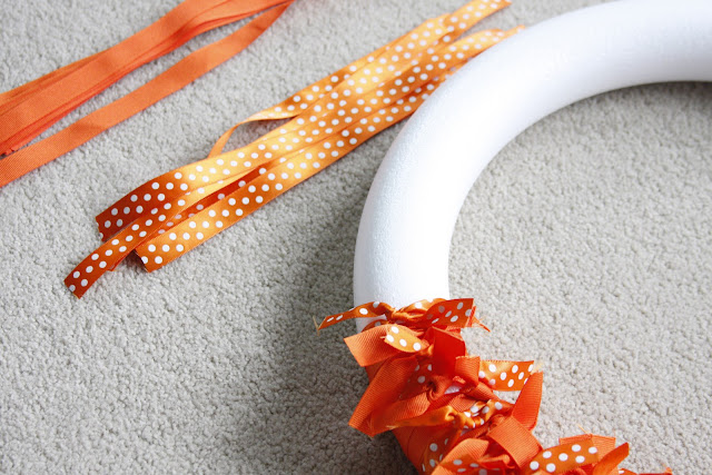 cut ribbon and tied knots on wreath