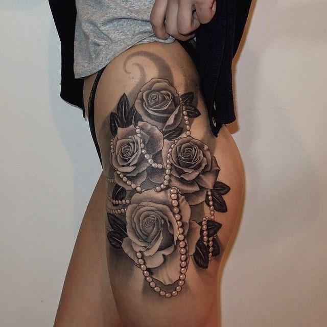 ♥ ♫ ♥ Gorgeous realistic black ink roses with a string of pearls laced throughout tattoo.....beautiful! Done by artist bangbangnyc ♥ ♫ ♥