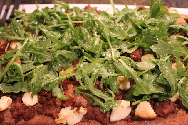 Lamb pizza with peppers and arugula