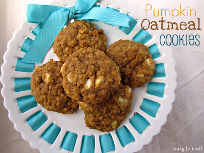 pumpkin oatmeal cookies with white chocolate chips on white platter with teal ribbon overhead shot with words
