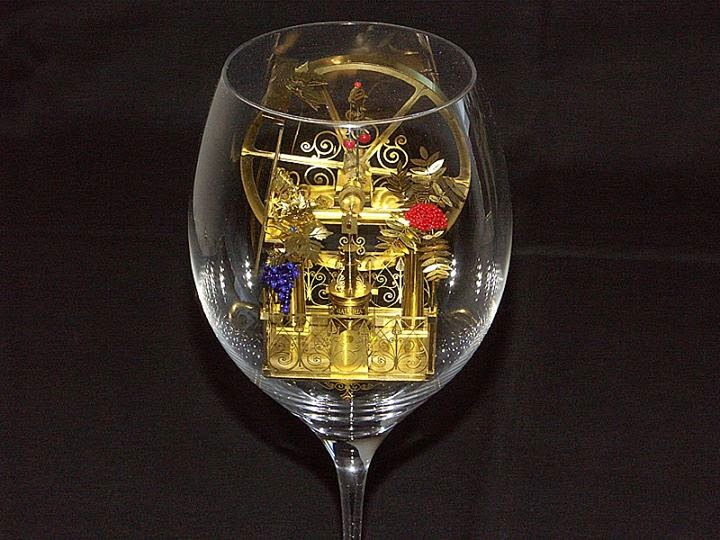08-Solar-Kinetic-Miniature-Sculptures-in-a-Glass-Goblet-www-designstack-co