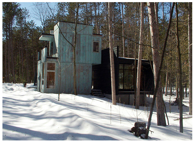 small house in woods in winter