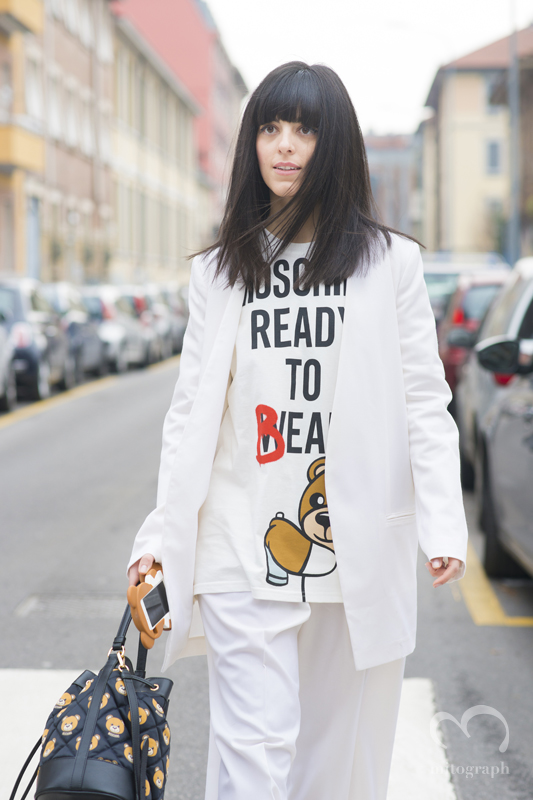 Laura Comolli wears new Moschino T-shirt and iphone case and bag at Milan Fashion Week 2015-2016 Fall Winter MFW
