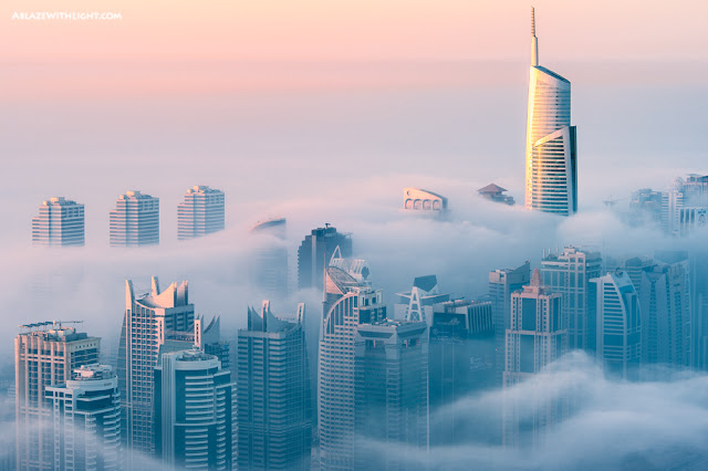 Photo of Dubai skyscrapers drowning in the morning fog