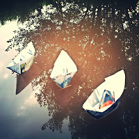 Paper boats on the canal
