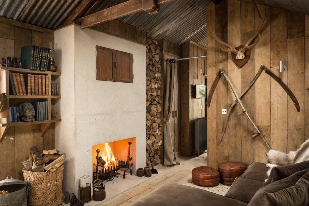 Caba a de madera decorada con estilo r stico for Trofeos caza decoracion