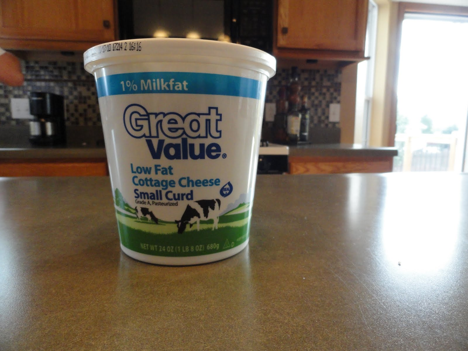 24 oz. container costs that is 6 servings for 1/2 cup or 4oz.