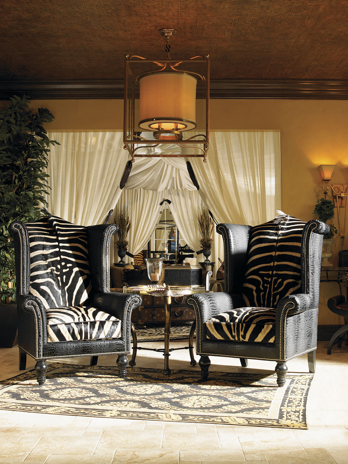 these types of chairs also often feature decorative nail heads source unknown covered in bold upholstery modern wingback