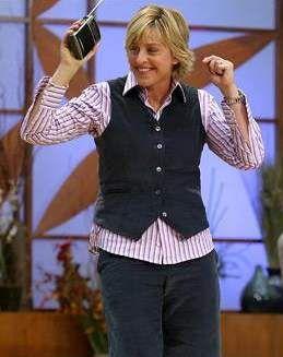 Ellen DeGeneres dancing with arms waving