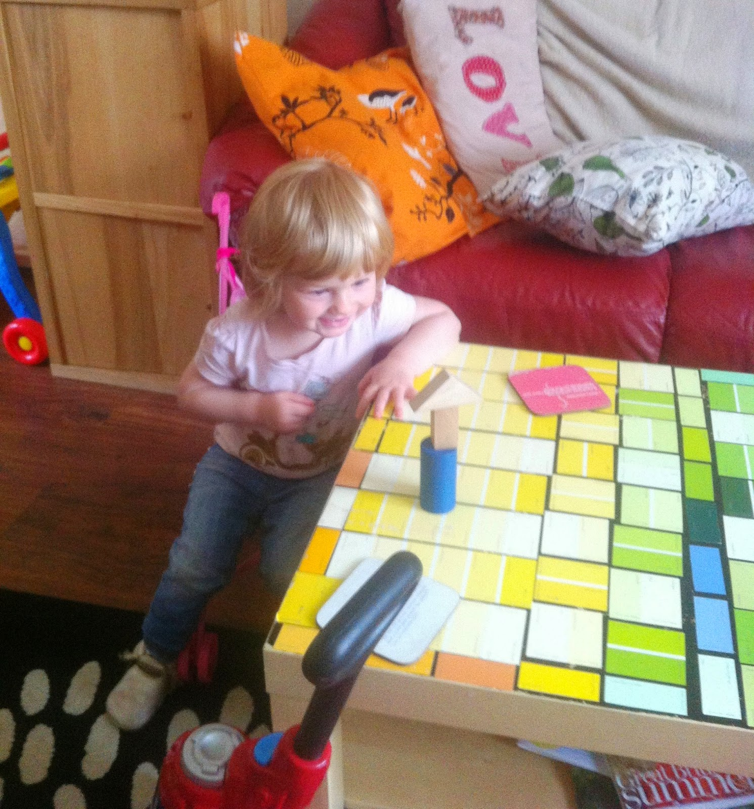 Eva stacking her blocks