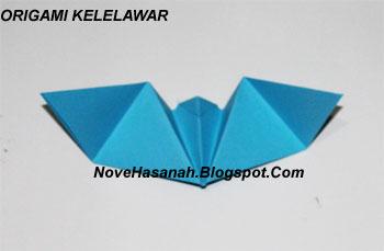 langkah-langkah melipat kertas origami untuk membuat bentuk binatang kelelawar yang unik, cocok untuk anak SD kelas 4, 5, dan 6, serta untuk pemula