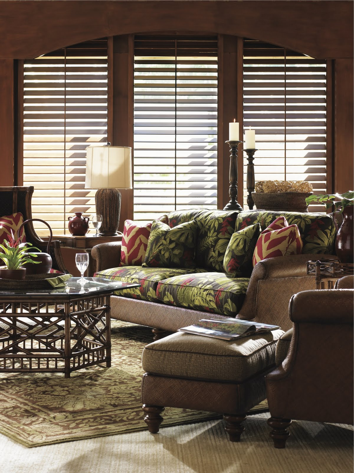 Tommy Bahama living room has darker colors. title=