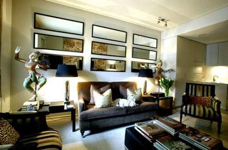 cheap and atractive living room decor using unique wall mirror