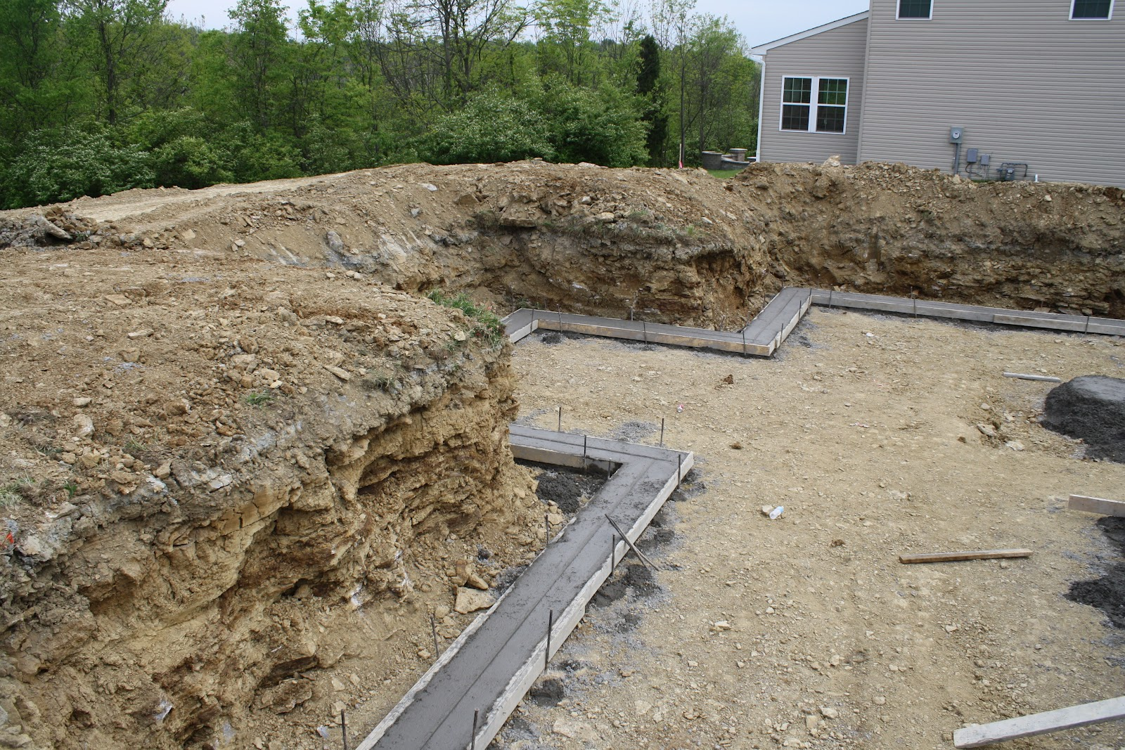 Building a fischer homes whitman digging and footers for Digging foundation for house