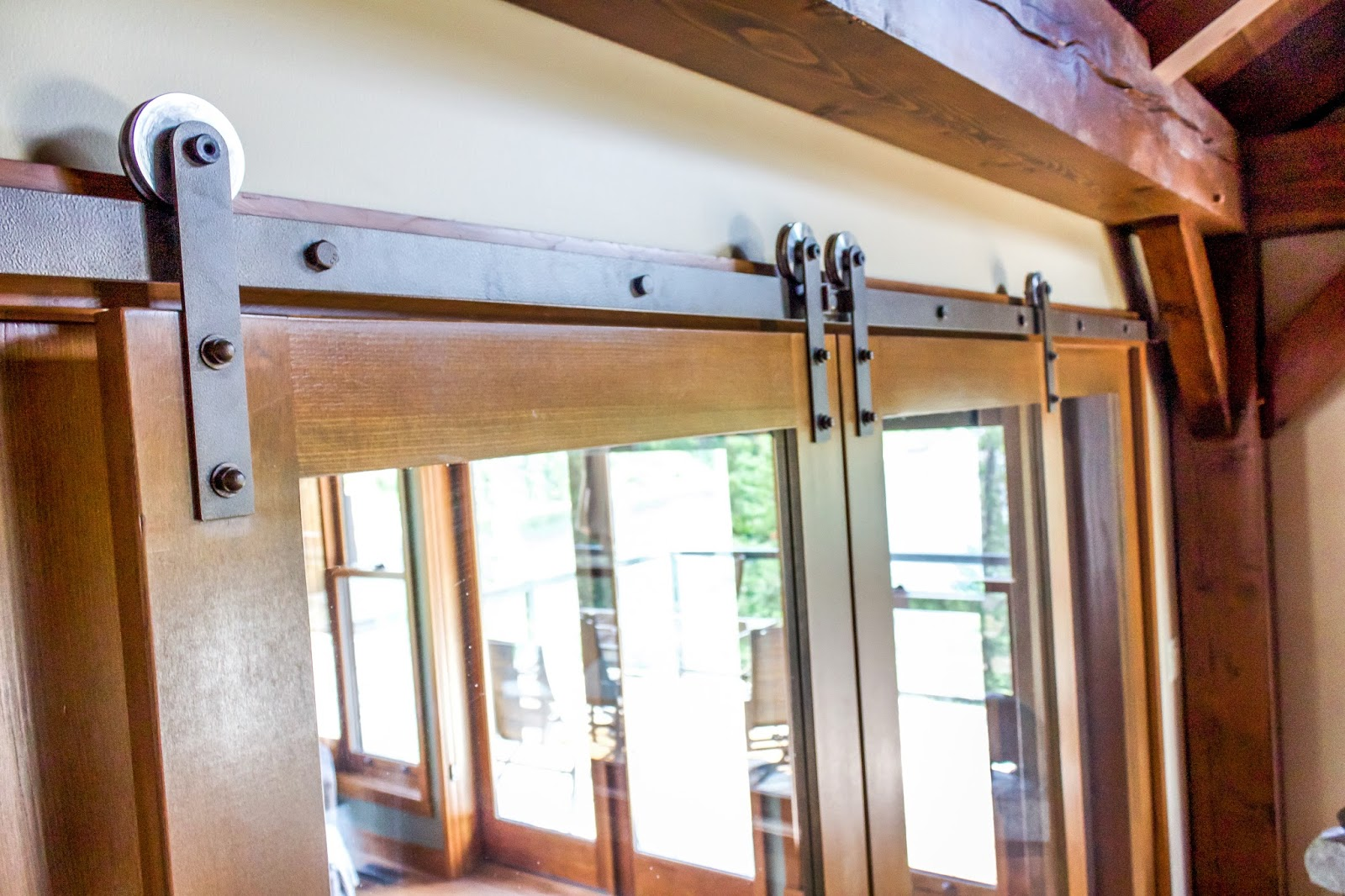 These Doors However Rest On A Set Of Metal Rails That Maintain Rustic Aesthetic Our Mountain Lodge But Are Largely Composed Glass Panels
