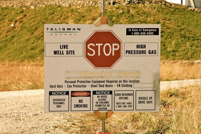 Mixed message: a warning sign at a fracking site in Pennsylvania (Credit: Ostroff Law via Wikimedia Commons) Click to enlarge.