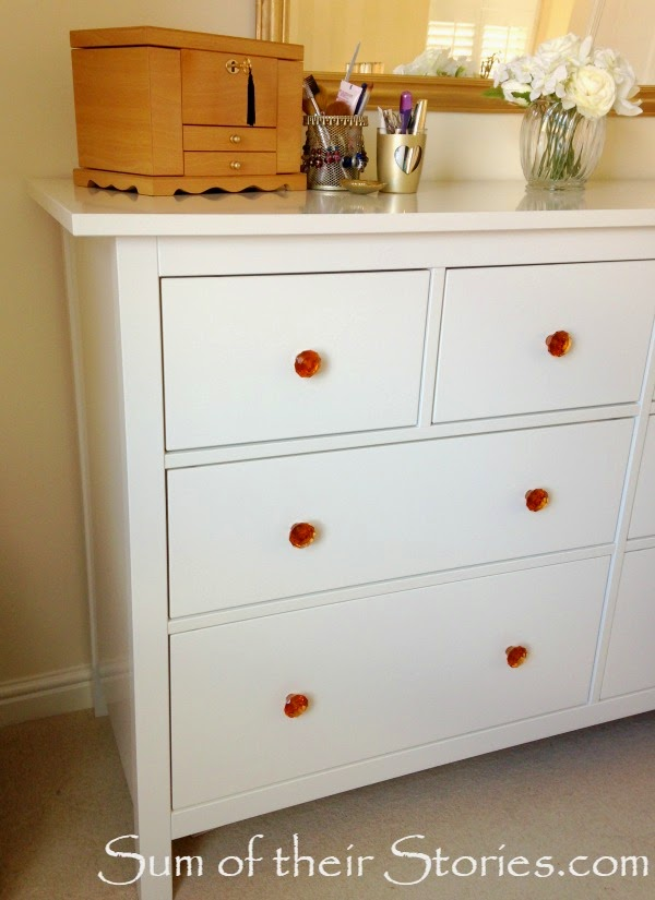new glass knobs on dresser