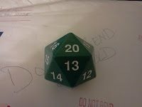 A green, fist-sized d20 used for tabletop role playing games