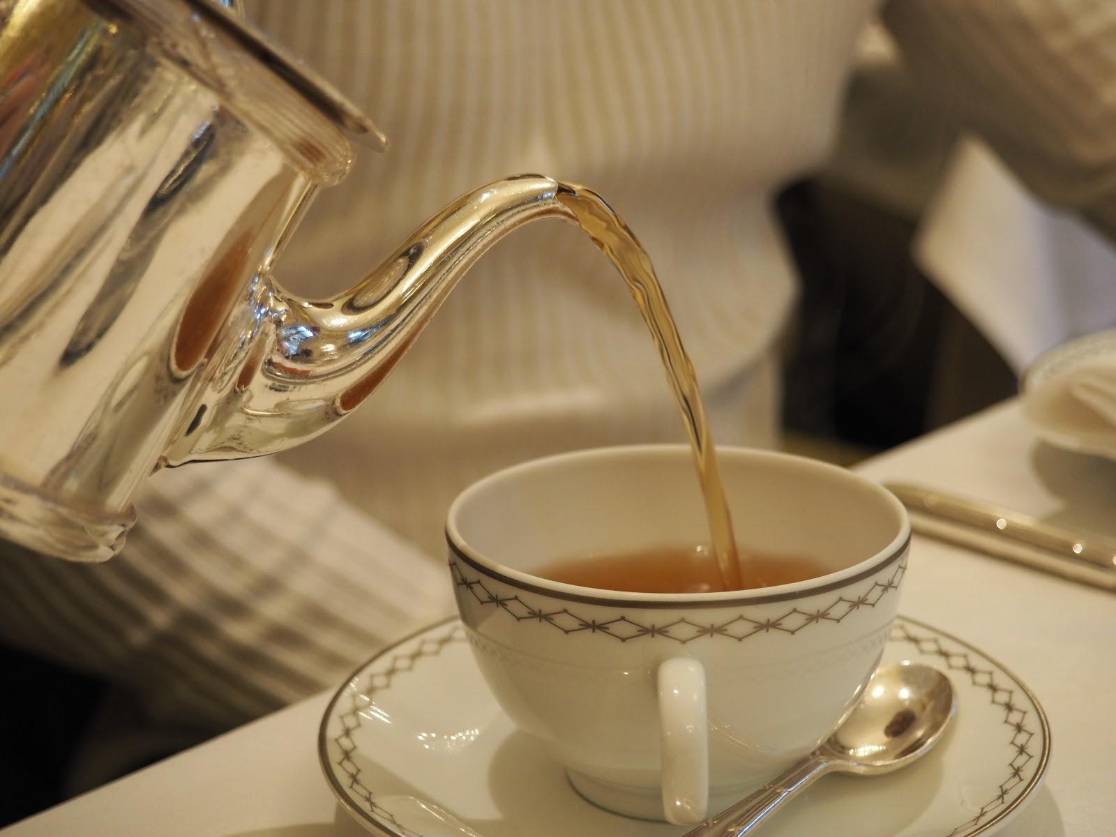 Peninsula Hotel, Paris, Afternoon Tea, Silver Tea Pot pouring tea in cup