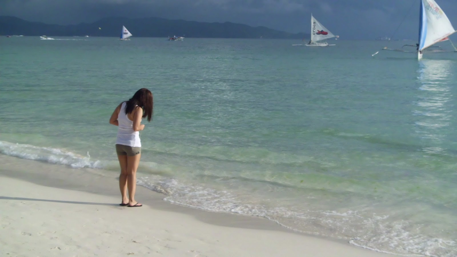 This girl was taking a photo of her feet in the sand. Typical of everybody, really.