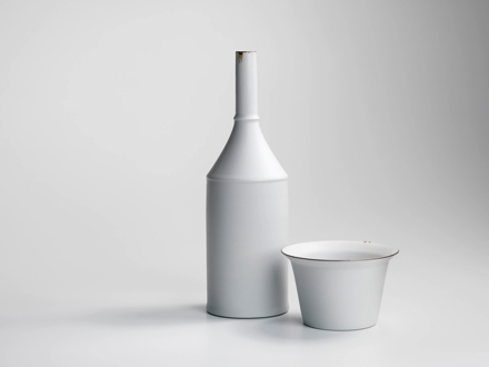 white porcelain bottle and bowl