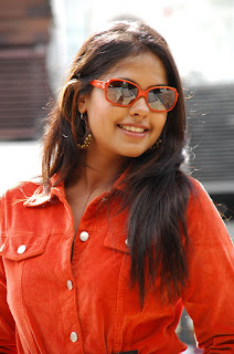 Bindu Madhavi Looks Funny in her Orange Top and Goggles Spicy Smile