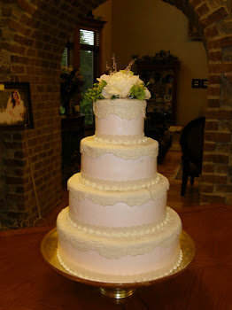 4-tier round buttercream with fondant lace appliques