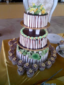 .3 tier wedding cake & cupcakes.
