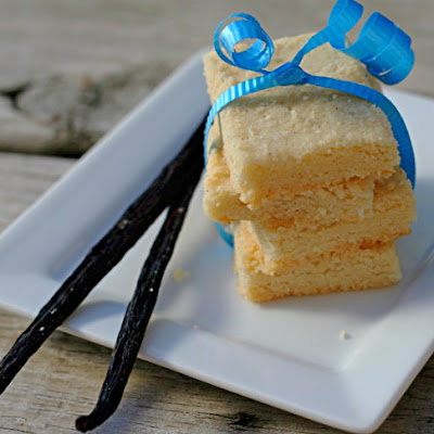 vanilla bean shortbread stacked and tied with a blue ribbon