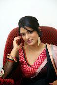 Nidhi Natuiyal Glamorous Photos in Saree-thumbnail-9