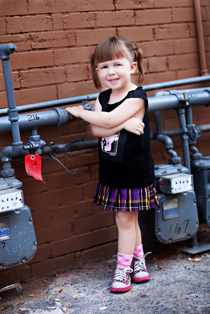 Little girl wears a edgy outfit for her photo shoot with a Tucson photographer