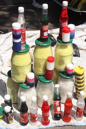 Frascos contendo enxofre e outros produtos