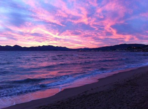 The pink and purple sky as the sun sets over the bay of Cannes