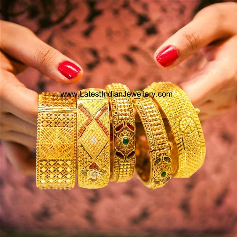 Broad Gold Bangles Collection