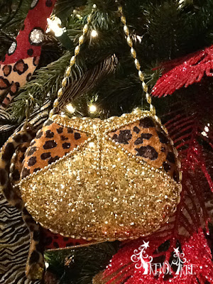 http://www.trendytree.com/raz-christmas-and-halloween-decor/raz-amimal-print-purse-christmas-decoration-set-of-2.html