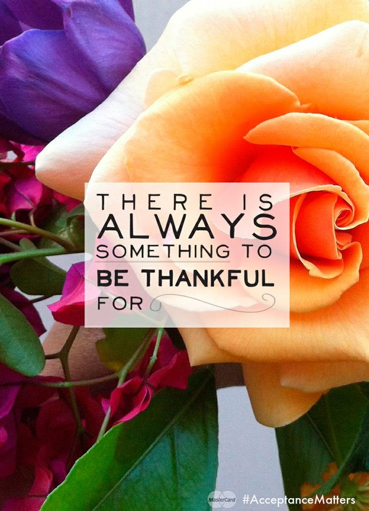 """There is always something to be thankful for."" Picture of a rose. MasterCard"