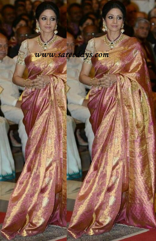 Latest saree designs sridevi in beautiful pink kanchipuram silk saree checkout actress sridevi in beautiful pink kanchipuram silk saree with heavy zari all over the saree and paired with matching short sleeves work designer altavistaventures Image collections