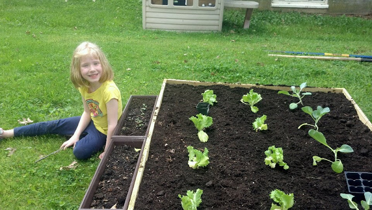 Rylee growing in her garden!