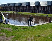 Afbeelding 1. Het waterplein in 's-Hertogenbosch tijdens de full scale test (Foto: Floris Boogaard). In: Waterpleinen voor klimaatadaptatie - case Eikendonkplein 's-Hertogenbosch
