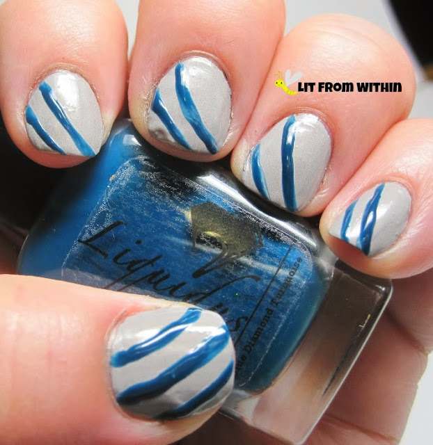 The first set of stripes I did with a nail art brush and Liquidus Blue Diamond Turquoise