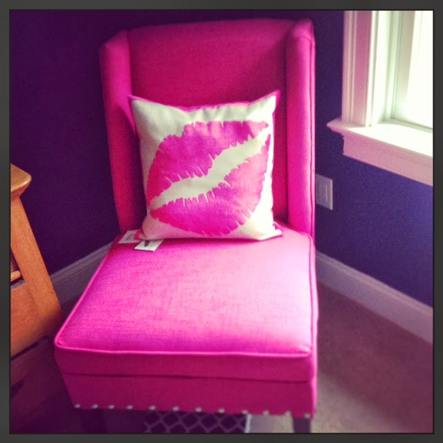 found this fuchsia chair at home goods and it adds a pop of color in