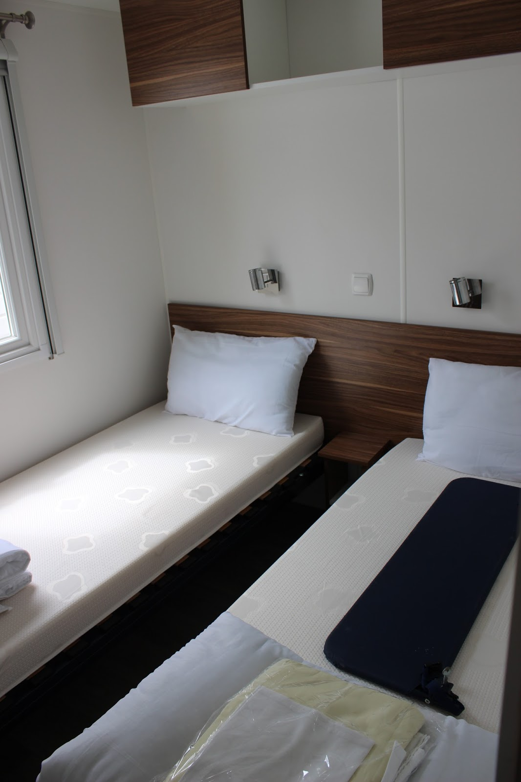the double and twin beds were camping bed style and one of the beds were already missing a few slats the bedroom windows all come with a black out blind