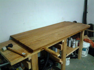 A sharp, functional work bench is quickly constructed from rescued hard yellow pine boards. (easy DIY work table)