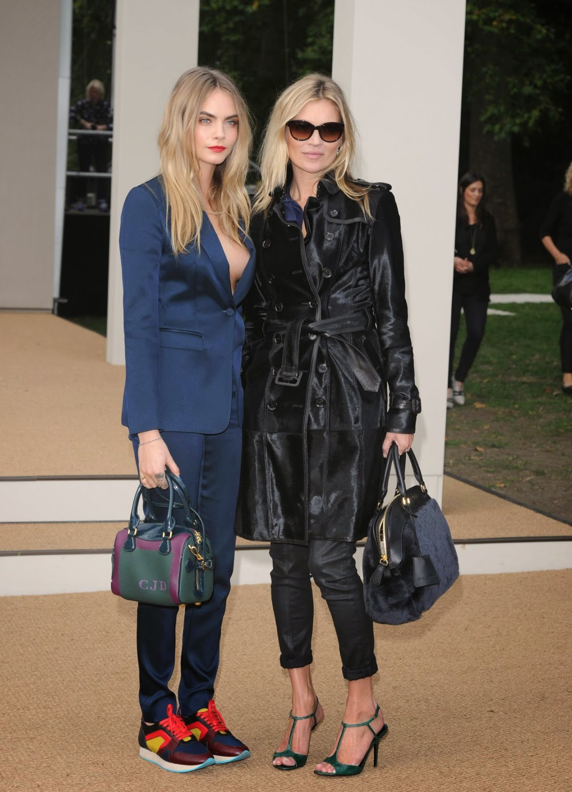 Kate Moss and Cara Delevingne arrive hand in hand to the Burberry Prorsum Spring 2015 London Fashion Week Show
