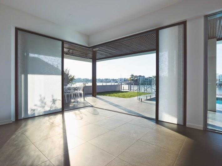 Light-filtering shades in action built-into folding doors & The Door Industry Journal: Centor Integrated Doors \u0027make the view ...