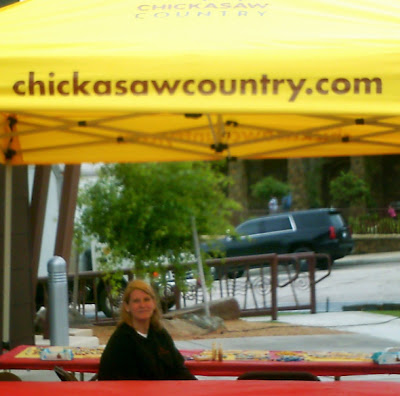 chickasawcountry.com's tent  at 2015 Artesian Art Festival.